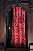 red curtain in a confessional