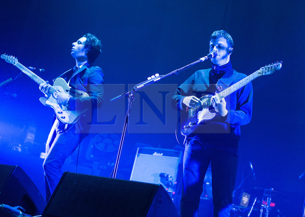 © Licensed to London News Pictures. 01/12/2014. London, UK.   The Maccabees performing live at Brixton Academy, supporting headliner Kasabian.  In this picture - Hugo White (left), Orlando Weeks (right). The Maccabees are an indie rock band consisting of members Orlando Weeks (vocals), Hugo White (guitars, Felix White (guitars, backing vocals), Rupert Jarvis (bass), Sam Doyle (drums), Will White (keyboards).  Photo credit : Richard Isaac/LNP