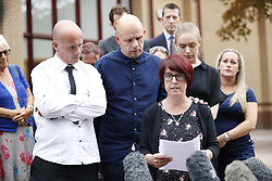 © Licensed to London News Pictures. 18/07/2018. Woking, UK. The family of Private (Pte) Sean Benton leave Woking Coroner's Court after hearing the coroner's verdict. Pte Benton's sister Tracy Lewis and twin brother Tony Benton heard the coroner read out his verdict that Sean died of self inflicted gunshot wounds to the cheesy. Pte Sean Benton was found with five gunshot wounds to his chest at Deepcut army base in 1995. Photo credit: Peter Macdiarmid/LNP