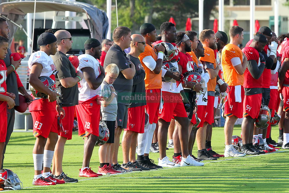 July 28, 2018 - Tampa, FL, U.S. - TAMPA, FL - JULY 28: The Tampa Bay Buccaneers and staff including General Manager Jason Licht stand at attention during the playing of the National Anthem before the Tampa Bay Buccaneers Training Camp on July 28, 2018 at One Buccaneer Place in Tampa, Florida. (Photo by Cliff Welch/Icon Sportswire) (Credit Image: © Cliff Welch/Icon SMI via ZUMA Press)