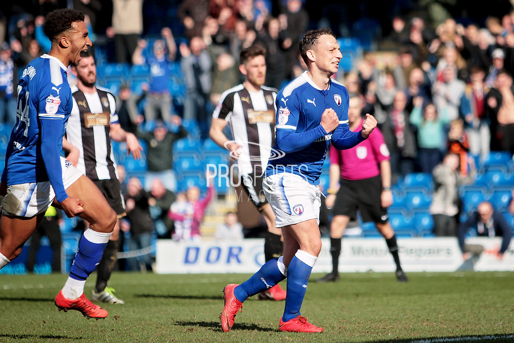 Chesterfield forward Kristian Dennis (9) celebrates his last gasp penalty during the EFL Sky Bet League 2 match between Chesterfield and Notts County at the Proact stadium, Chesterfield, England on 25 March 2018. Picture by Nigel Cole.