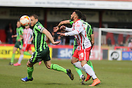 Jake Mulraney midfielder for Stevenage FC (29) tussle with Barry Fuller (Captain) defender for AFC Wimbledon (2) during the Sky Bet League 2 match between Stevenage and AFC Wimbledon at the Lamex Stadium, Stevenage, England on 30 April 2016. Photo by Stuart Butcher.