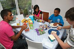 Multiracial group preparing food