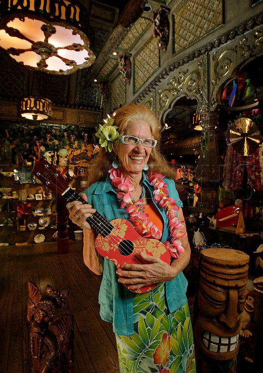 Store manager Hazel Quire shows off her ukulele at the Mai Kai Restaurant in Fort Lauderdale. Hazel has been working there since 1982.