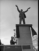 Jim Larkin Statue. O'Connell Street Dublin.   (M77)..1979..15.06.1979..06.15.1979..15th June 1979..Today saw the unveiling of a statue in memory of James (Big Jim) Larkin. Larkin was a trade union activist who was a thorn in the side of many employers who refused to allow workers join unions. A dispute with The Dublin United Tramway Company  escalated into what is now known as the great lock out. Employers banded together and wanted workers to sign a pledge stating that they would not join Larkin's union the Irish Transport And General workers Union (ITGWU). The lock out lasted seven months. During this time Larkin was nited for his rhetoric in standing up for the poor and oppressed within Irish Society...Jim Larkin: Born Jan 21 1876 .Died Jan 30 1947...Image of President, Dr Patrick Hillery drawing the cord to unveil the Jim Larkin engraving.