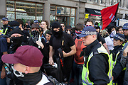 Police herding demonstrators away into the nearby underground station gathered to oppose the Free Tommy Robinson demonstration, organised by anti-fascist groups including Stand up to Racism opposed to far right politics on 24th August 2019 in London, United Kingdom. Some 250 Stand Up To Racism and other anti-fascist groups took to the streets today in opposition to supporters of jailed 'Tommy Robinson' real name Stephen Yaxley-Lennon at Oxford Circus, who gathered outside the BBC.
