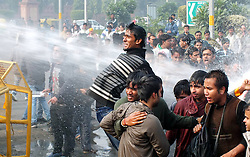 A protestor confronts water cannoned by police during a demonstration at the India Gate in New Delhi, India, December 23, 2012. Photo by Imago / i-Images...UK ONLY