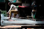 Selling ice in the market, Siem Reap, in Cambodia. PHOTO TIAGO MIRANDA