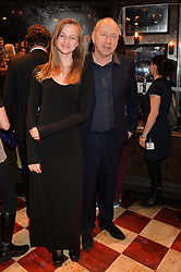 MARK KNOPFLER and his daughter ISABELLA KNOPFLER at a gala performance of 'Once The Musical' in aid of Oxfam held at the Phoenix Theatre, 110 Charing Cross Road, London on 17th March 2014.