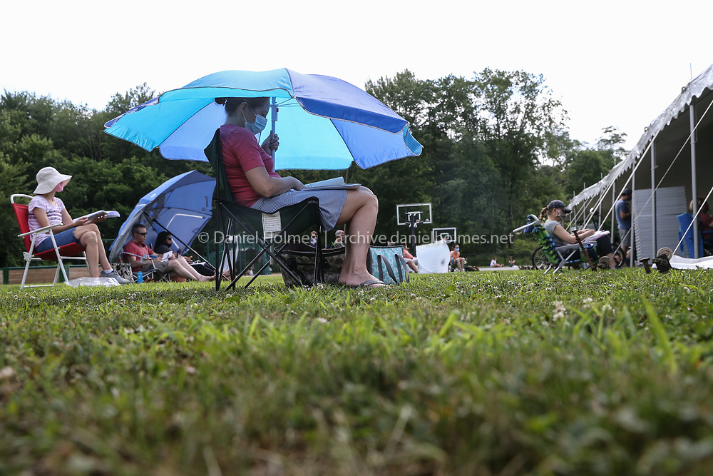 (7/11/20, STOW, MA) Stow resident Tara Buck sat outside during a socially distanced town meeting at the Center School in Stow on Saturday. [Daily News and Wicked Local Photo/Dan Holmes]