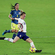 ORLANDO, FL - JANUARY 22:  Emily Sonnett #14 of United States kicks the ball against Colombia at Exploria Stadium on January 22, 2021 in Orlando, Florida. (Photo by Alex Menendez/Getty Images) *** Local Caption *** Emily Sonnett