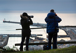 © Licensed to London News Pictures. 01/01/2019. Dover, UK. Photographers watch for activity in the Channel from Dover as Border Force monitors shipping in the middle of the English Channel.  As the number of migrants willing to risk crossing the English Channel from France continues to grow, the UK government have increased the number of Border Force Cutters available to three.  Photo credit: Peter Macdiarmid/LNP