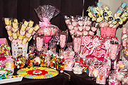 A buffet of pink sweets and candy for a child's party
