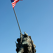 The Iwo Jima Memorial (formally the Marine Corps War Memorial) in Arlington, Virginia, next to Arlington National Cemetery. The monument was designed by Felix de Wledon and is based on an iconic Associated Press photo called the Raising the Flag on Iwo Jima by Joe Rosenthal. It was dedicated in 1954.