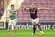 Stephen Kingsley (#3) of Heart of Midlothian FC runs past David Turnbull (#14) of Celtic FC during the Cinch SPFL Premiership match between Heart of Midlothian FC and Celtic FC at Tynecastle Park, Edinburgh, Scotland on 31 July 2021.