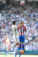 Real Madrid's Carlos Henrique Casemiro and Atletico de Madrid's Antoine Griezmann during La Liga match between Real Madrid and Atletico de Madrid at Santiago Bernabeu Stadium in Madrid, April 08, 2017. Spain.<br /> (ALTERPHOTOS/BorjaB.Hojas)