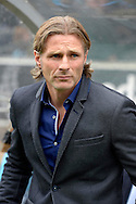 Gareth Ainsworth, the Wycombe Wanderers manager looks on from the dugout before k/o. Skybet football league two match, Wycombe Wanderers v Hartlepool Utd at Adams Park in High Wycombe, Bucks on Saturday 5th Sept 2015.<br /> pic by John Patrick Fletcher, Andrew Orchard sports photography.