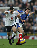 Photo: Lee Earle.<br /> Portsmouth v Tottenham Hotspur. The Barclays Premiership. 01/01/2007. Tottenham's Steed Malbranque (L) battles with Sean Davis.