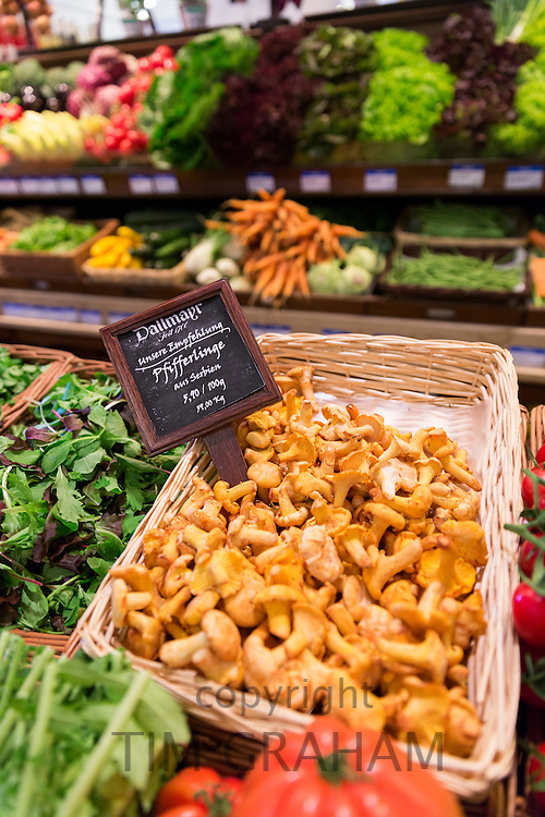 Chanterelle mushrooms and vegetables on display at Dallmayr food store in Munich in Bavaria, Germany