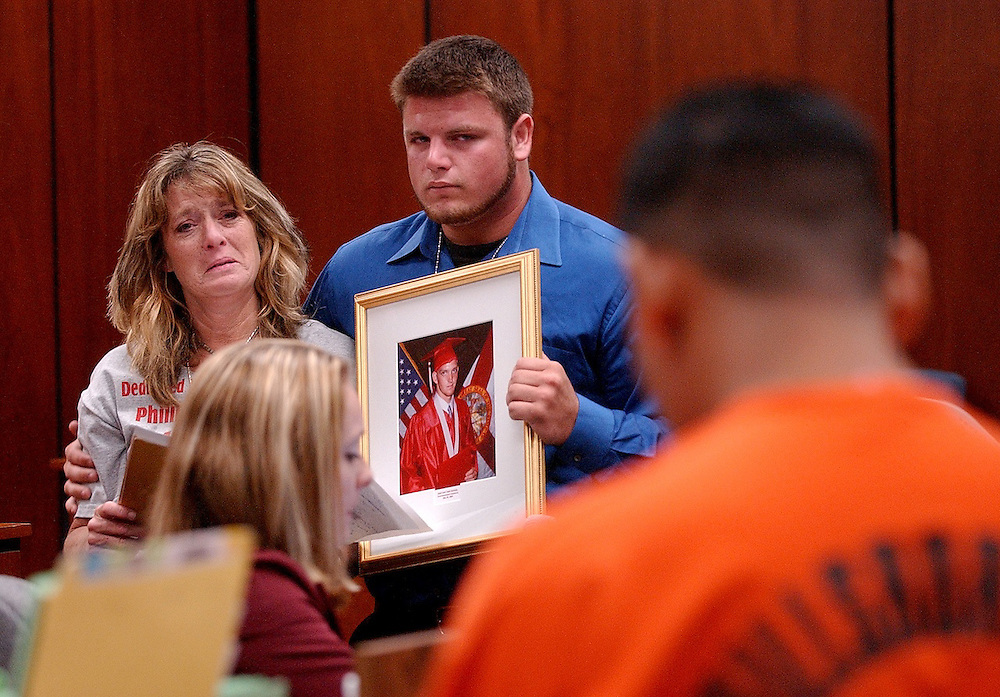 5/9/06 -- TAMPA -- Lisa Pyche and her son Travis Combs speak to Isaac Vasquez in Hillsborough County Criminal Circuit Court on May 9, 2006. Vasquez, who was convicted for the DUI manslaughter of Pyche's son P.J., was sentenced to the maximum 15 years.
