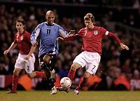 Photo: Jed Wee.<br /> England v Uruguay. International Friendly. 01/03/2006.<br /> <br /> England captain David Beckham (R) with Uruguay's Mario Regueiro.