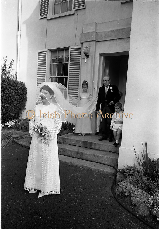 """16/09/1967<br /> 09/16/1967<br /> 16 September 1967<br /> Wedding of Mr Francis W. Moloney, 28 The Stiles Road, Clontarf and Ms Antoinette O'Carroll, """"Melrose"""", Leinster Road, Rathmines at Our Lady of Refuge Church, Rathmines, with reception in Colamore Hotel, Coliemore Road, Dalkey. Image shows the bride leaving home before  the ceremony with her father Mr Dudley O'Carroll in the doorway."""