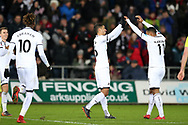 Kyle Naughton of Swansea city (l) celebrates with teammate Luciano Narsingh after he scores his teams 5th goal. The Emirates FA Cup, 4th round replay match, Swansea city v Notts County at the Liberty Stadium in Swansea, South Wales on Tuesday 6th February 2018.<br /> pic by  Andrew Orchard, Andrew Orchard sports photography.