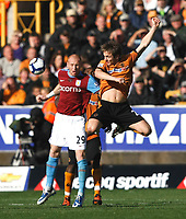 Photo: Steve Bond/Richard Lane Photography. Wolverhampton Wanderers v Aston Villa. Barclays Premiership 2009/10. 24/10/2009. Kevin Doyle leaps for the ball in front of James Collins