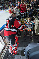 KELOWNA, CANADA - NOVEMBER 9: Zach Sawchenko #31 of Team WHL gives a puck to a young fan at the end of the first period against the Team Russia on November 9, 2015 during game 1 of the Canada Russia Super Series at Prospera Place in Kelowna, British Columbia, Canada.  (Photo by Marissa Baecker/Western Hockey League)  *** Local Caption *** Zach Sawchenko;