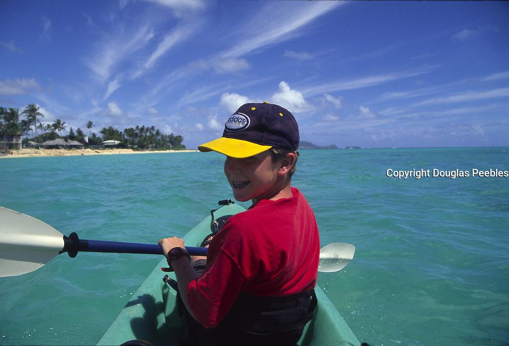 Boy kayaking, Kanikai, Oahu, Hawaii<br />