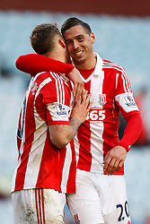Stoke Goalscorer Stoke Marko Arnautovic (AUT) is higged by Forward Marko Arnautovic (AUT) after a 1-4 victory - Photo mandatory by-line: Rogan Thomson/JMP - 07966 386802 - 23/03/2014 - SPORT - FOOTBALL - Villa Park, Birmingham - Aston Villa v Stoke City - Barclays Premier League.