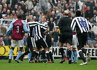Photo. Andrew Unwin, Digitalsport<br /> Newcastle United v Aston Villa, Barclays Premiership, St James' Park, Newcastle upon Tyne 02/04/2005.<br /> Newcastle's Kieron Dyer (C) is restrained by Stephen Carr (L) and Nicky Butt (R) as he fights with his team-mate Lee Bowyer. Both were sent off for fighting.