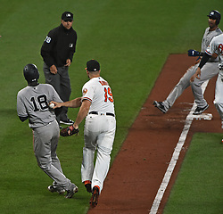 May 30, 2017 - Baltimore, MD, USA - Baltimore Orioles first baseman Chris Davis, center, tags out the New York Yankees' Didi Gregorius, left, in a run down between third and home in the ninth inning at Oriole Park at Camden Yards in Baltimore on Tuesday, May 20, 2017. The Yankees won, 8-3. (Credit Image: © Kenneth K. Lam/TNS via ZUMA Wire)
