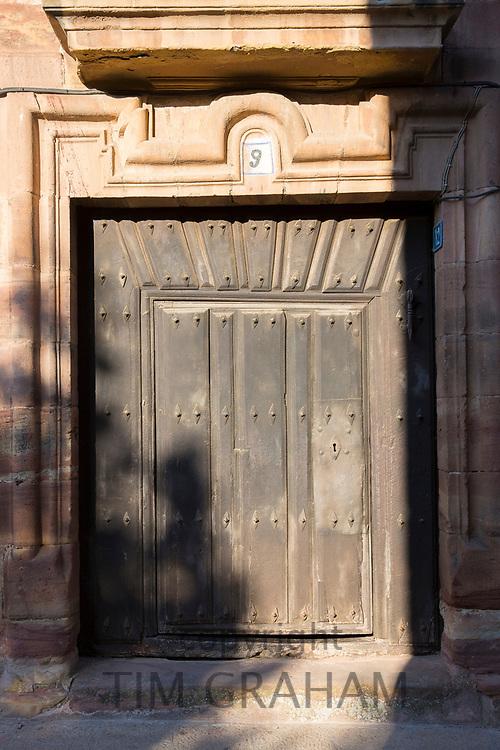 Old oak doorway in Calle del Angel in Ezcaray, La Rioja, Spain