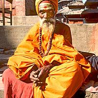 Nepal, Kathmandu.  Hindu ascentic (sadhu) on temple steps, Durbar Square.