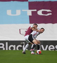 Erik Pieters of Burnley (L) and Chris Basham of Sheffield United in action - Mandatory by-line: Jack Phillips/JMP - 05/07/2020 - FOOTBALL - Turf Moor - Burnley, England - Burnley v Sheffield United - English Premier League