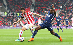 Stoke City's Ramadan (left) and Tottenham Hotspur's Serge Aurier (right) battle for the ball