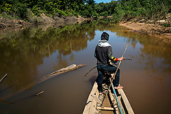 NO WEB/NO APPS - Exclusive. (Text available) A fisherman stands on the tip of his canoe looking at the river in search of his prey, in 'Palma Real' native community, near Puerto Maldonado, Peru on July 17, 2017. The Amazon rainforest is famous as 'The Lung of the Earth', but also for the presence of numerous native communities, who have always lived isolated and in close contact with nature for generations, used to seek for food and medicines and to build items directly from the environment in which they live. The unstoppable rise of globalization has drastically changed their needs, expectations and consequently their way of life. Located in the Tambopata National Reserve, on the border between Peru and Bolivia, the native Comunidad Palma Real is one of the clearest examples of this change. Living on the banks of the Madre de Dios River since approximately 1976, Palma Real comprises about 300 people part of the nomadic community Ese-Eja, established in the Amazon rainforest of Peru before the Spanish colonization. Photo by Giacomo d'Orlando/ABACAPRESS.COM