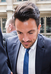 © Licensed to London News Pictures. 16/07/2015. London, UK. PETER ANDRE arrives at the High Court today. PETER ANDRE has been called as a witness in a contract dispute between his former TV producer, Neville Hendricks and ITV2. Photo credit : Vickie Flores/LNP