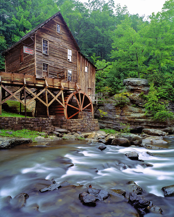 Against a green backdrop, the Glade Creek Grist Mill displays an eerie, quiet beauty, in Babcock State Park, West Virginia.