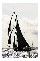 A Classic Gaff rigged yacht racing at the Americas Cup Jubilee off Cowes..Marc Turner / PFM.