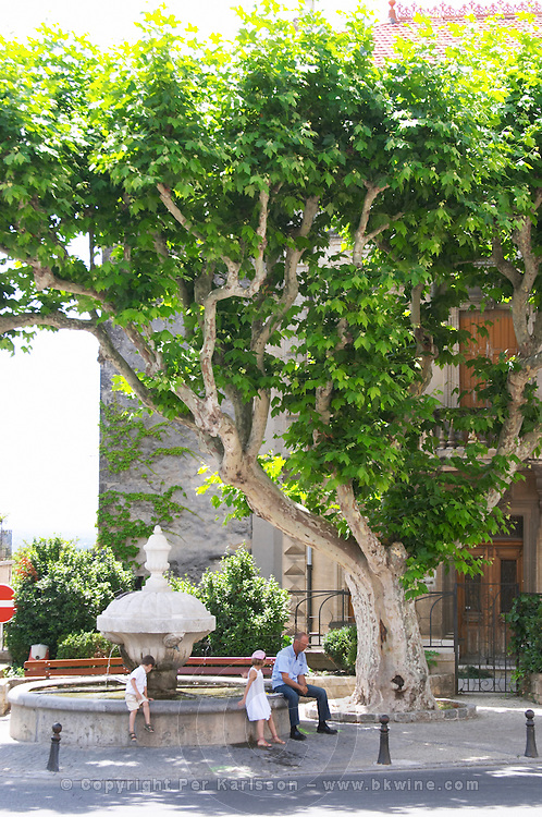 fountain in the main square chateauneuf du pape rhone france