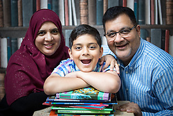 © Licensed to London News Pictures . 19/08/2015 . Oldham , UK . SAMI AKBAR (11) (correct) from Ashton , pictured with his mother SAFINA SHAHEEN (45) (correct) and father SHOAIB AKBAR (44) (correct) . Sami took and passed his GCSE maths at the age of ten . He achieved a B in two Higher Maths papers . Photo credit : Joel Goodman/LNP