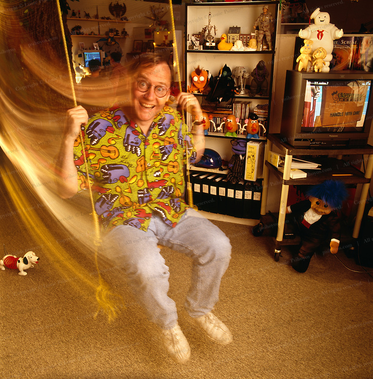 John Lasseter on the eve of his first hit Toy Story at Pixar headquarters in California.  The Pixar offices are very playful and feature swings and scooters to keep the atmosphere cheerful.