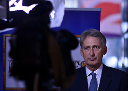 © Licensed to London News Pictures. 03/10/2012. Birmingham, UK Defence Secretary Philip Hammond gives a television interview on Day 1 at The Conservative Party Conference at the ICC today 7th October 2012. Photo credit : Stephen Simpson/LNP