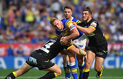 Leeds Rhinos' Brad Dwyer is tackled by Warrington Wolves' Declan Patton  and Dominic Crosby during the Ladbrokes Challenge Cup Semi Final match at the Macron Stadium, Bolton. PRESS ASSOCIATION Photo. Picture date: Sunday August 5, 2018. See PA story RUGBYL Warrington. Photo credit should read: Dave Howarth/PA Wire. RESTRICTIONS: Editorial use only. No commercial use. No false commercial association. No video emulation. No manipulation of images.