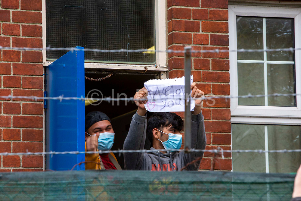 Refugees inside the barracks came out to enjoy the locals 'Welcome To Folkestone' event from local residents and community groups including Kent Refugee Action Network and Samphire came together outside Napier Barracks to show the people staying there that they are welcome to the town on the 17th of October 2020 in Folkestone, United Kingdom. In September 2020 Napier Barracks a former military camp was transformed into an assessment and dispersal facility for 400 asylum seekers by the Home Office.