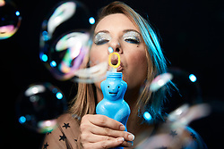 Close up of Woman Blowing Soap Bubbles