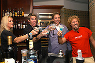 Rockers Lita Ford, from left, Mark McGrath, of Sugar Ray, Hard Rock Hotel general manager Lou Carrier, and rocker Sammy Hagar, formerly of Van Halen, say a cheer before drinking during the opening of The Kitchen restaurant at the Hard Rock Hotel at the Universal Orlando Resort in Orlando, Florida.