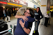 Passengers hug each other at Heathrow Airport, Terminal 3 as airports across Europe begin to get passengers home after being closed because of the Volcano in Iceland.
